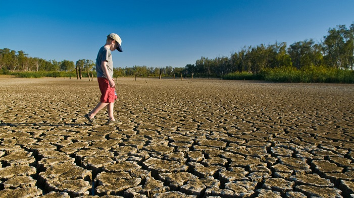 istock boy on dry lake bed 157418252 1200 x 630